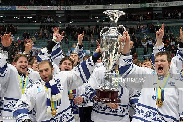 Russian Dynamo Moscow hold the trophy after the final game against Finland's Karpat Oulu at the European Champions Cup tournament in Saint Petersburg...