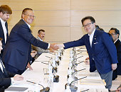 Russian Economic Development Minister Alexey Ulyukaev and Japanese Deputy Chief Cabinet Secretary Hiroshige Seko shake hands prior to their talks at...