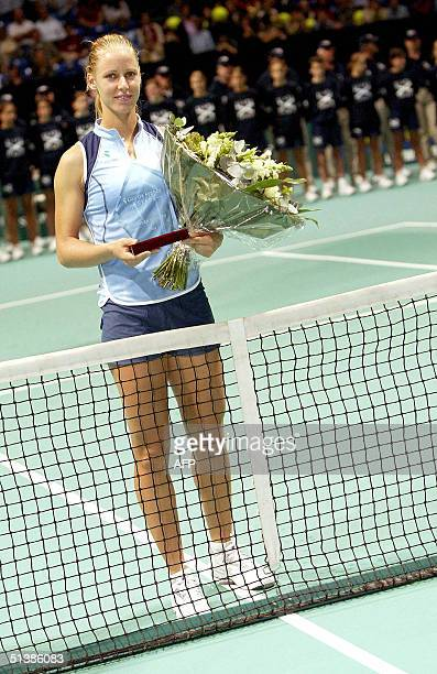 Russian Elena Dementieva holds the winner's trophy after defeating compatriot Elena Bovina during the final match of the Gaz de France Stars tennis...