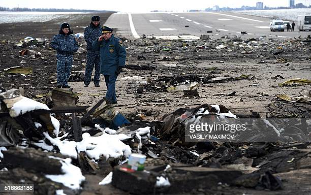 Russian Emergency Ministry rescuers examine the wreckage of a crashed airplane at the RostovonDon airport on March 20 2016 Investigators in southern...