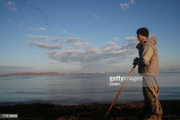 Russian Emergency Ministry soldiers remove oil pollution from the Black Sea shore on November 14 2007 near the southern port of Kavkaz Russia A...