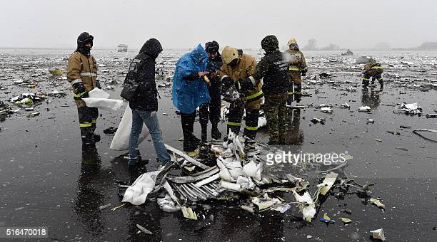 Russian emergency rescuers and forensic investigators work on the wreckage of the flydubai passenger jet which crashed killing all 62 people on board...