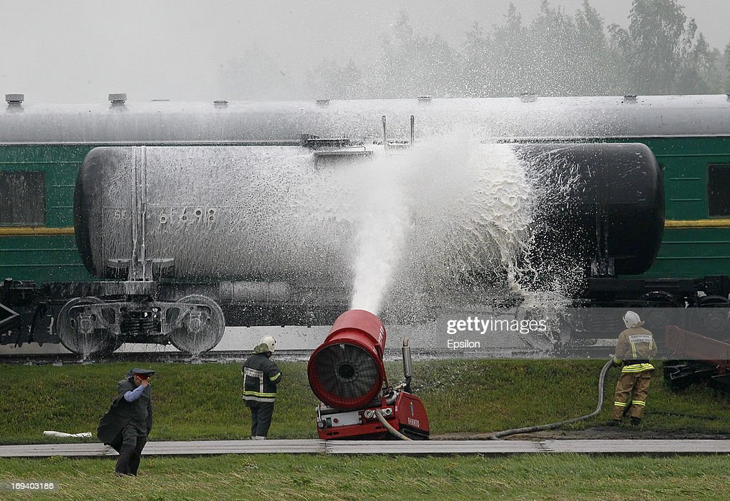 Russian Emergency Situations Ministry douse a train during simulation exercises by the Russian Emergency Situations Ministry, at their Rescue Training Centre on May 24, 2013 in Noginsk, outside Moscow, Russia.