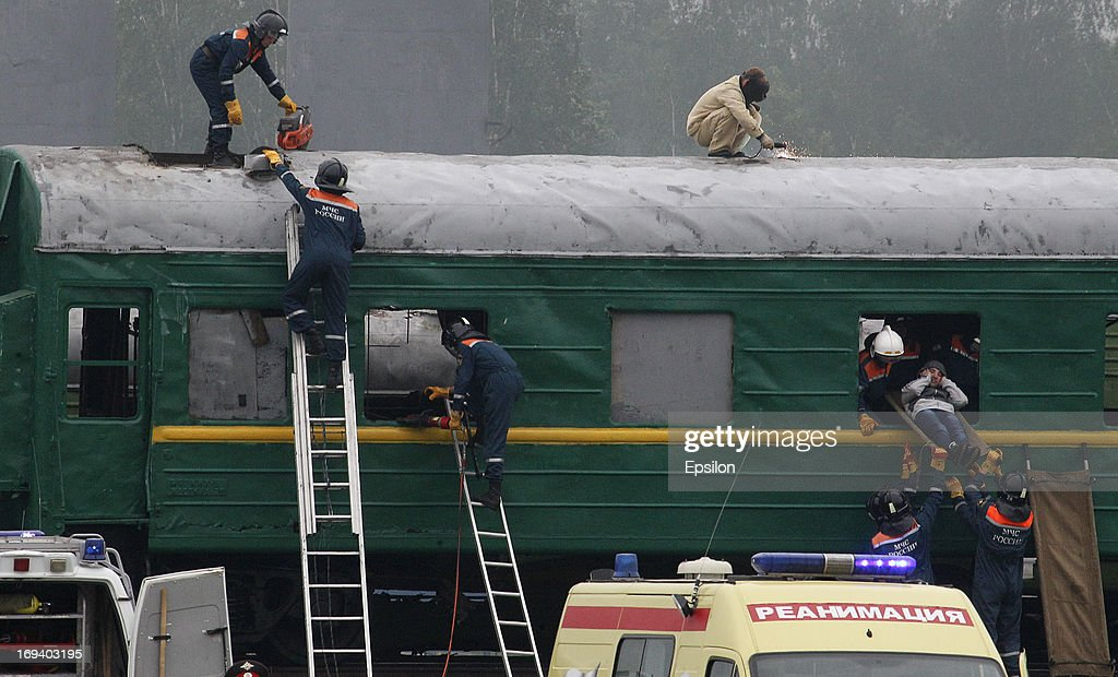 Russian Emergency Situations Ministry evacuate a 'casaulty' from a train during simulation exercises by the Russian Emergency Situations Ministry, at their Rescue Training Centre on May 24, 2013 in Noginsk, outside Moscow, Russia.