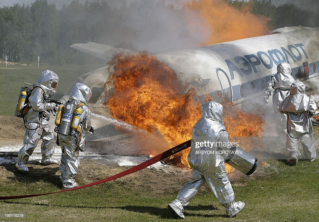 Russian Emergency Situations Ministry workers put out a fire during a training exercise 60 km from Moscow in Noginsk on May 21, 2010. Various emergency and military special units held a day of training activities.