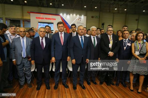 Russian Energy Minister Aleksandr Novak and Turkish Foreign Minister Mevlut Cavusoglu attend the opening ceremony of Russian Federation stand within...