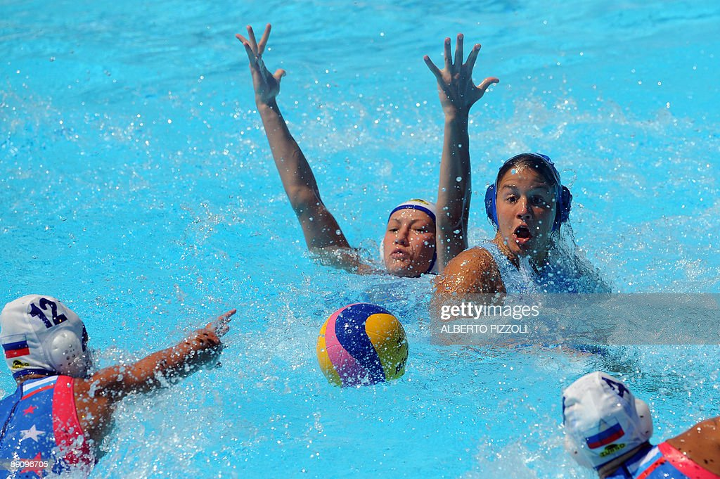 Russian Eugenia Ivanova and Sofya Konukh try to grab the ball during the waterpolo 1st round match Russia vs Greece at the FINA World Swimming...
