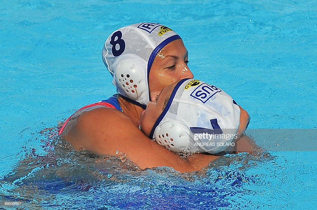 Russian Evgenia Ivanova celebrates with her teammate Ekaterina Pantyulina after their victory over Greece at the end of the Women' waterpolo...