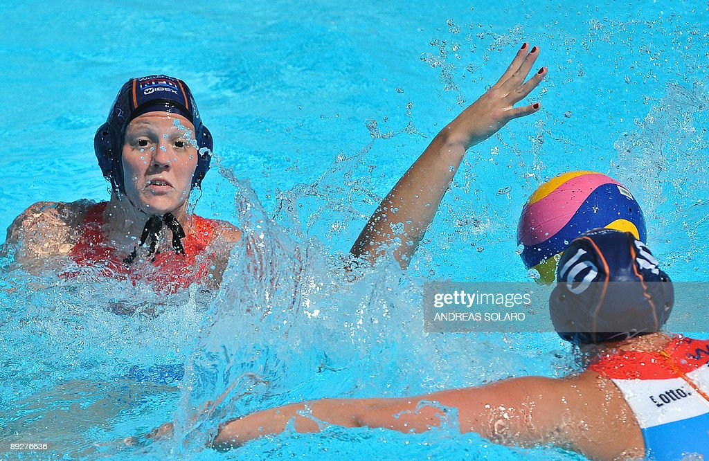 Russian Evgenia Ivanova fights for the ball against Netherlands players during the waterpolo Quarterfinal Women Russia Vs Netherlands on July 27 2009...