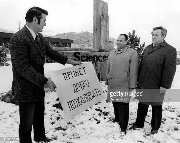 Russian Experts Visit Colorado Plant Bill Walker left senior project manager of Earth Sciences Inc welcomes two Russian experts with a sign in their...