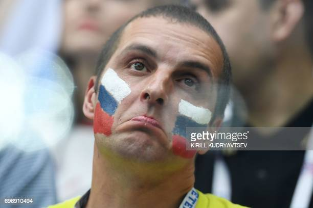 A Russian fan attends the 2017 Confederations Cup group A football match between Russia and New Zealand at the Krestovsky Stadium in SaintPetersburg...