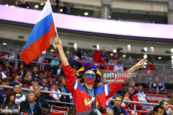 Russian fan holds up a flag before the game between Russia and the United States during the Men's Ice Hockey Preliminary Round Group A game on day...