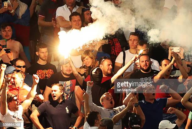 Russian fan holds up two flares during the UEFA EURO 2016 Group B match between England and Russia at Stade Velodrome on June 11 2016 in Marseille...
