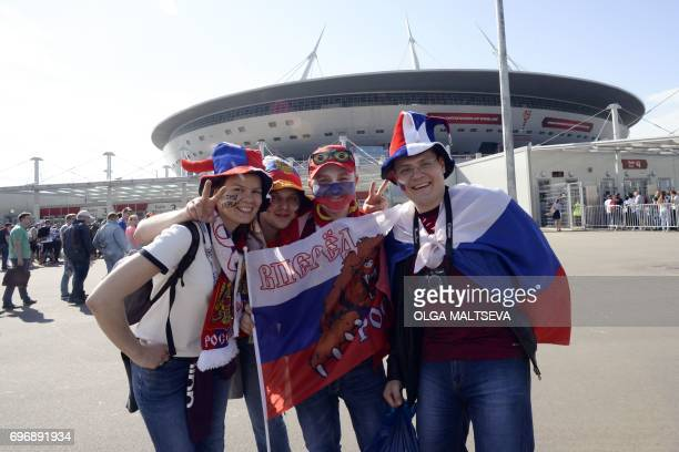 Russian fans arrive for the 2017 Confederations Cup group A football match between Russia and New Zealand at the Krestovsky Stadium in...