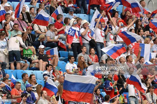 Russian fans attend the 2017 Confederations Cup group A football match between Russia and New Zealand at the Krestovsky Stadium in SaintPetersburg on...