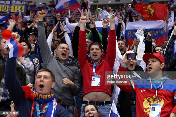 Russian fans celebrate after a goal in the third period against Slovenia during the Men's Ice Hockey Preliminary Round Group A game on day six of the...