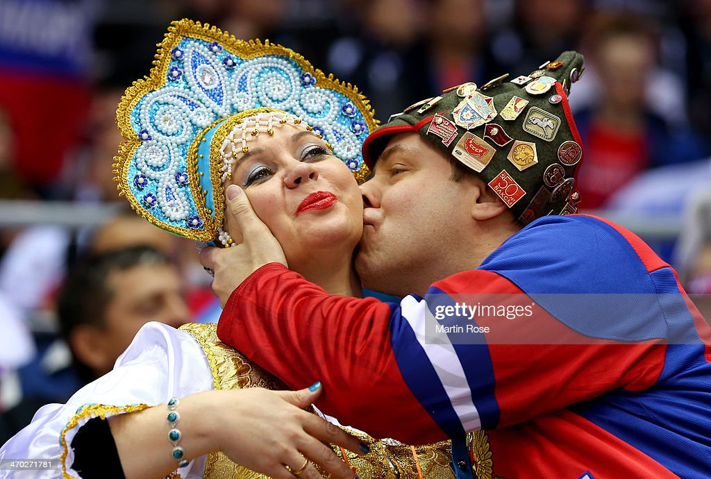 Russian fans kiss during the Men's Ice Hockey Quarterfinal Playoff between Finland and Russia on Day 12 of the 2014 Sochi Winter Olympics at Bolshoy Ice Dome on February 19, 2014 in Sochi, Russia.