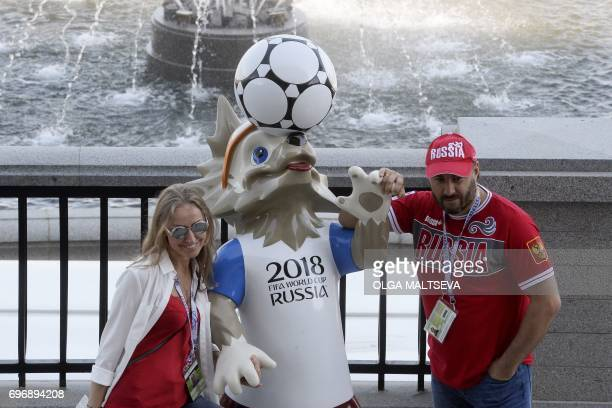 Russian fans pose for a photograph prior to the start of the 2017 Confederations Cup group A football match between Russia and New Zealand at the...
