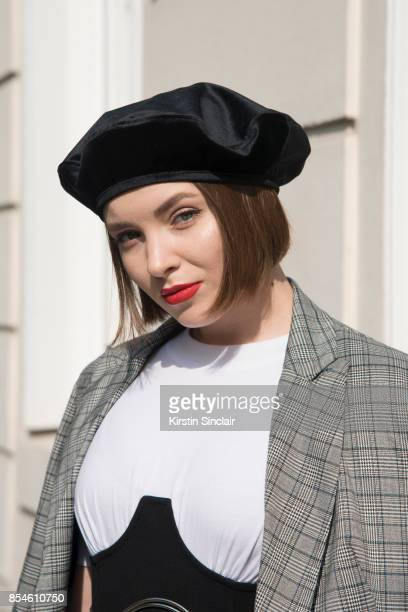 Russian fashion blogger and producer Lisaveta wears a Stradivarius jacket ASOS jumpsuit and a Zara hat day 1 of Paris Womens Fashion Week...