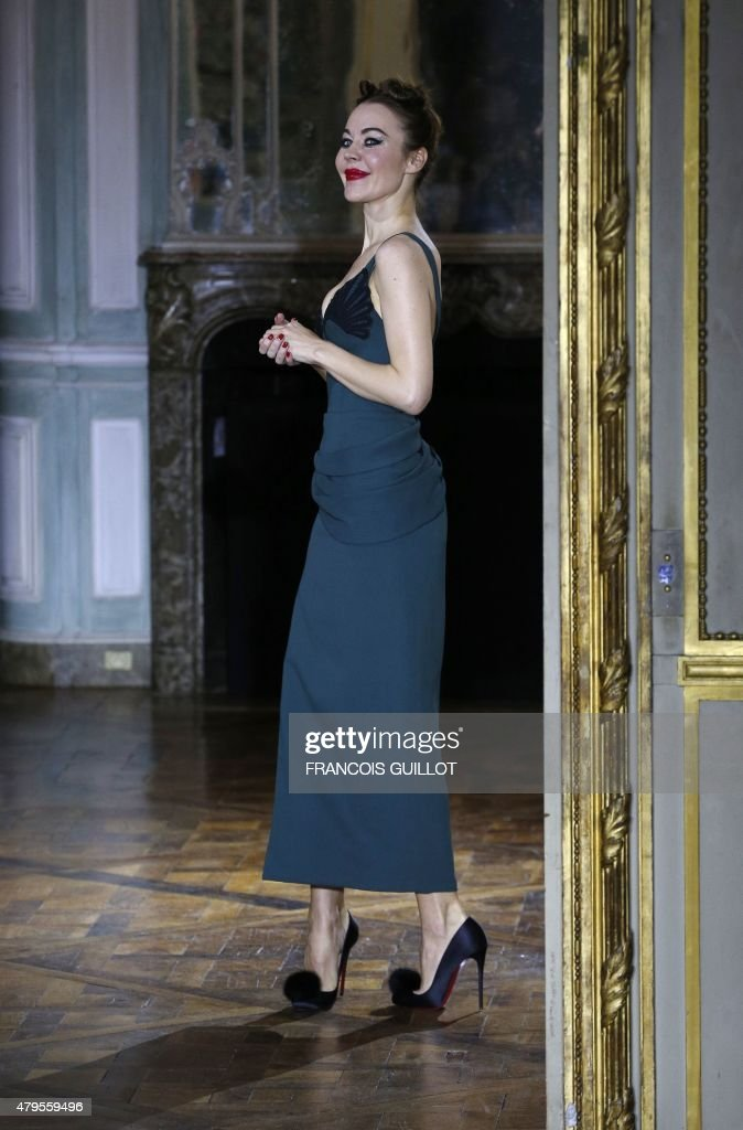 Russian fashion designer Ulyana Sergeenko greets the audience at the end of her Fall/Winter 20152016 haute couture fashion show in Paris on July 5 as...