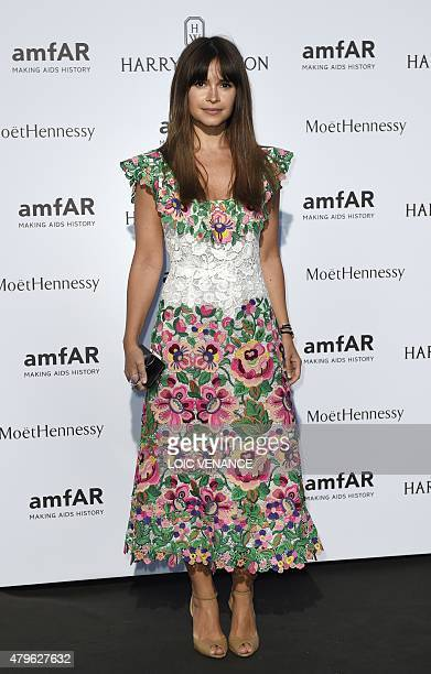 Russian fashion editor Miroslava Duma poses as she arrives for the amfAR dinner on the sidelines of the Paris fashion week in Paris on July 5 2015...
