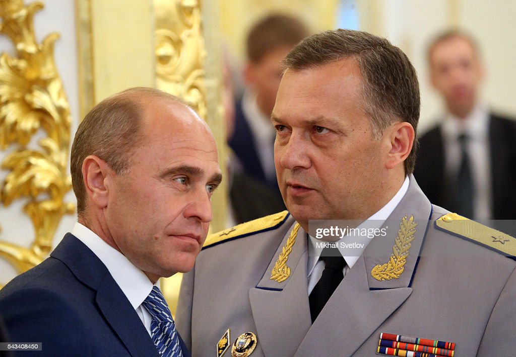 Russian Federal Guard Service (FSO) Chief Dmitry Kochnev (R) talks to Presidential Directorate's Head Alexander Kolpakov (L) during the reception for graduates of military academies and universtities at the Grand Kremlin Palace on June 28, 2016 in Moscow, Russia.