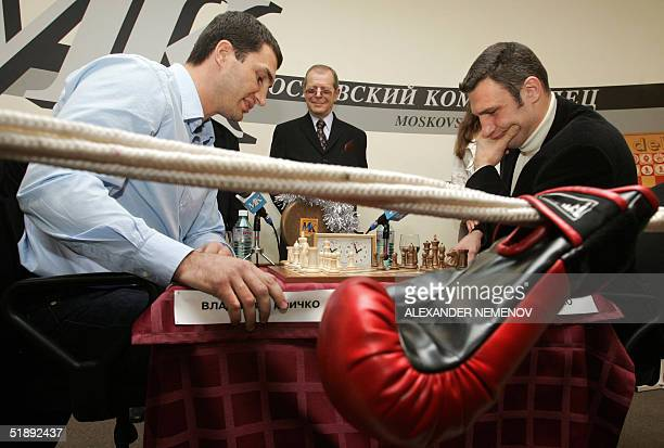 Famous Ukrainian world box champions brothers Vladimir and Vitaly Klichko play against each other in a fake chess match in Moscow 24 December 2004 on...