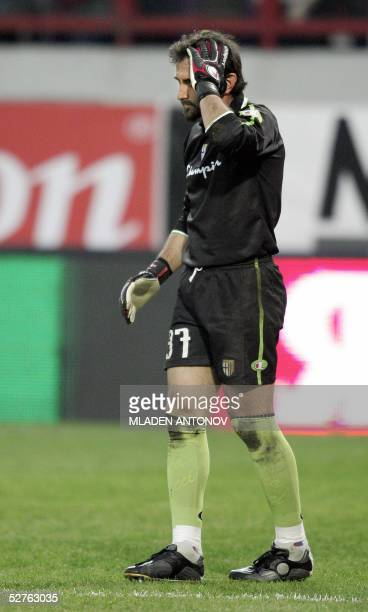 Parma FC's goalkeeper Luca Bucci leaves the game injured by fire cracker thrown by CSKA Moskva's fan during their UEFA Cup semifinal second leg...