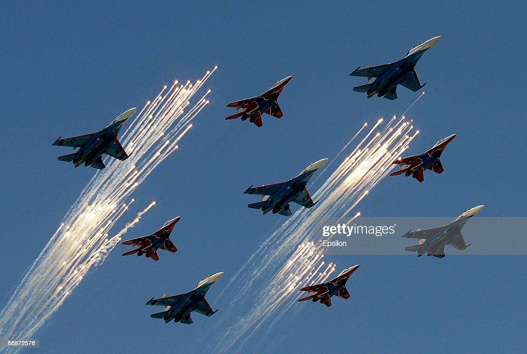 Russian fighter jets fire signal flares while flying during the nation's Victory Day parade in commemoration of the end of WWII held at the Red Square on May 9, 2009 in Moscow, Russia. The ceremony commemorates Victory Day of May 9, 1945 on which the World War II Allies' achieved victory over and unconditional surrender of Nazi Germany's armed forces.