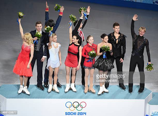 Russian figure skating team gold medal celebrates on the podium during the Figure Skating Team Flower Ceremony at the Iceberg Skating Palace during...