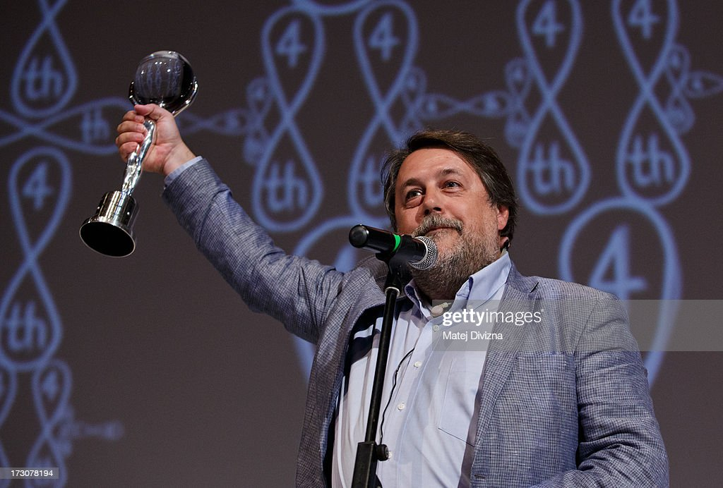 Russian film director Vitaly Manskiy poses with the Crystal Globe for Best Documentary Film Over 30 minutes Long after the closing ceremony of the 48th Karlovy Vary International Film Festival (KVIFF) on July 06, 2013 in Karlovy Vary, Czech Republic.