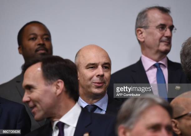 Russian Finance Minister Anton Siluanov looks on before the G20 Finance ministers group photo at the IMF headquarters in Washington DC on October 12...