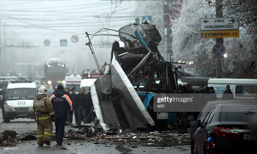 Russian firefighters and security personnel inspect the destroyed trolleybus in Volgograd on December 30 2013 Ten people were killed in a bombing...