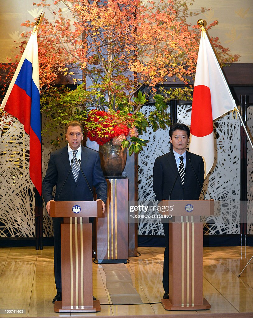 Russian First Deputy Prime Minister Igor Shuvalov (L) and Japanese Foreign Minister Koichiro Gemba speak to the media as they give a joint statement at the Iikura guesthouse in Tokyo on November 20, 2012. Both ministers attended the 10th meeting of the Japan-Russia Intergovernmental Committee on Trade and Economic Issues in Tokyo. AFP PHOTO / Yoshikazu TSUNO
