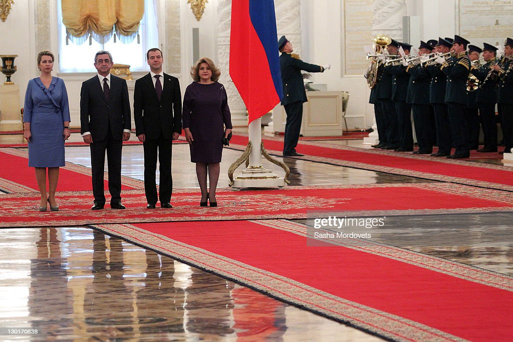 Russian First Lady <a gi-track='captionPersonalityLinkClicked' href=/galleries/search?phrase=Svetlana+Medvedev&family=editorial&specificpeople=5427737 ng-click='$event.stopPropagation()'>Svetlana Medvedev</a>a, Armenian President <a gi-track='captionPersonalityLinkClicked' href=/galleries/search?phrase=Serzh+Sargsyan&family=editorial&specificpeople=4583219 ng-click='$event.stopPropagation()'>Serzh Sargsyan</a>, Russian President <a gi-track='captionPersonalityLinkClicked' href=/galleries/search?phrase=Dmitry+Medvedev&family=editorial&specificpeople=554704 ng-click='$event.stopPropagation()'>Dmitry Medvedev</a> and Armenian First Lady Rita Sargsyan attend a welcoming ceremony at the Grand Kremlin Palace on October, 24, 2011 in Moscow, Russia. The President of Armenia and his wife were invited by his Russian counterpart for a state visit to Russia from 23 - 25 October.