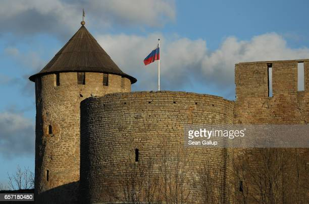 Russian flag flies over Ivangorod Fortress which lies on the Russian side of the Narva River as seen from the western Estonian side on March 23 2017...