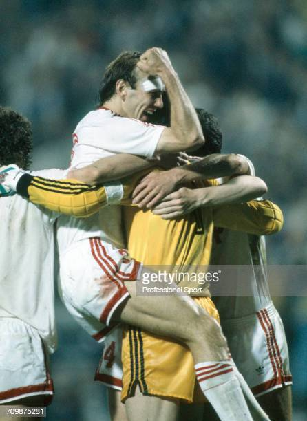 Russian footballer Vagiz Khidiyatullin is lifted up by goalkeeper Rinat Dasayev during celebrations by the Soviet Union team in the UEFA Euro 1988...