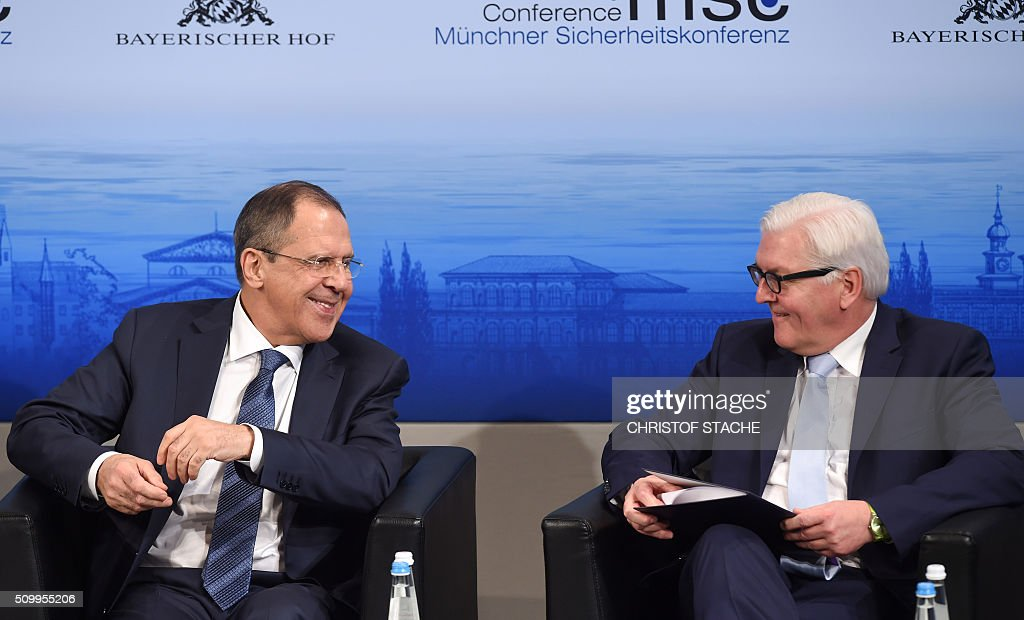 Russian Foreign Minister Sergei Lavrov (L) and German Minister of Foreign Affairs Frank-Walter Steinmeier (R) share a smile ahead a panel discussion of the 52nd Munich Security Conference (MSC) in Munich, southern Germany, on February 13, 2016. / AFP / Christof STACHE