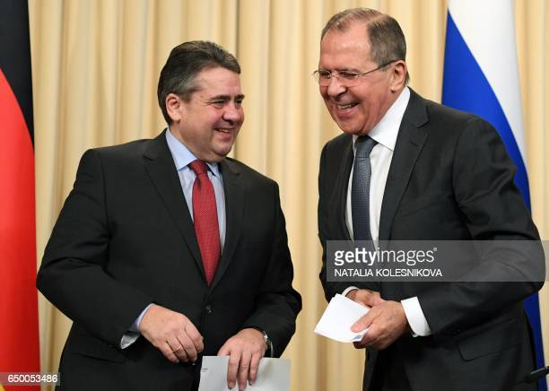 Russian Foreign Minister Sergei Lavrov and his German counterpart Sigmar Gabriel smile after a press conference in Moscow on March 9 2017 / AFP PHOTO...