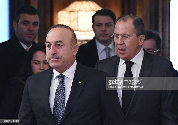 Russian Foreign Minister Sergei Lavrov and his Turkish counterpart Mevlut Cavusoglu arrive for their meeting in Moscow on December 20 2016 A Turkish...