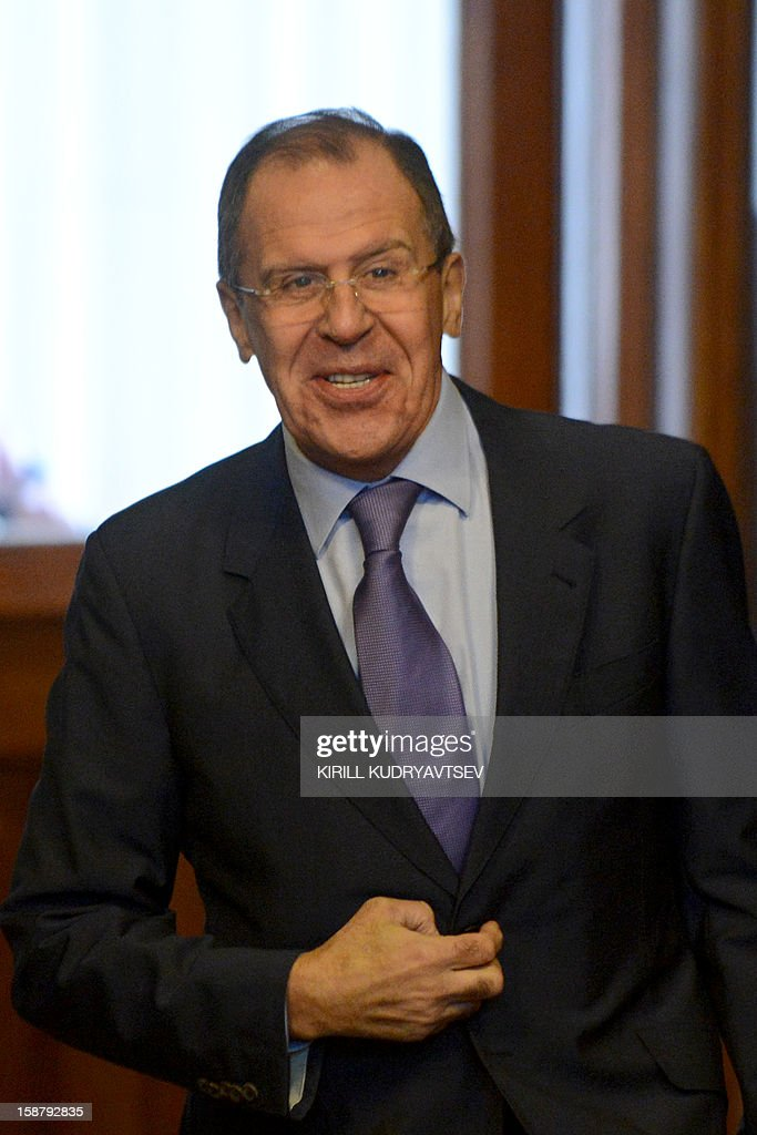 Russian Foreign Minister Sergei Lavrov arrives for talks with UN-Arab League peace envoy Lakhdar Brahimi in Moscow on December 29, 2012.