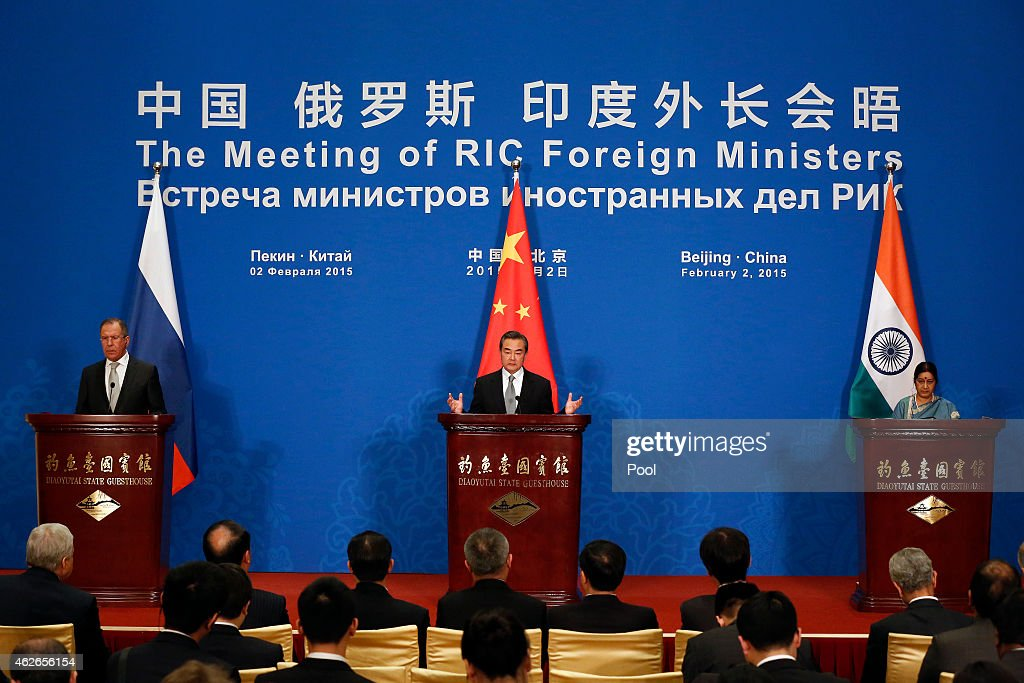 Russian Foreign Minister Sergei Lavrov (L), Chinese Foreign Minister Wang Yi (C) and Indian Foreign Minister Sushma Swaraj (R) attend the press conference after the 13th trilateral meeting of Foreign Ministers from Russia, India and China (RIC) at Diaoyutai State guesthouse on February 2, 2015 in Beijing, China. The Russian and Indian Foreign Ministers are in China for meetings with the Chinese leaders and to attend the 13th RIC trilateral meeting.