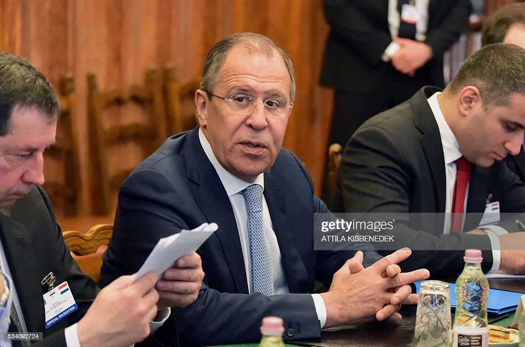 Russian Foreign Minister Sergei Lavrov (C) is seen during an official meeting with Hungary's Minister of External Economy and Foreign Affairs (not in picture) at the ministry in Budapest on May 25, 2016. / AFP / ATTILA