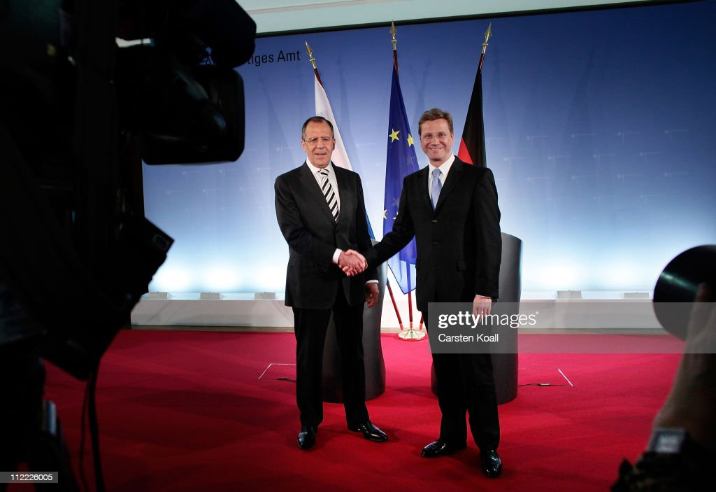 Russian Foreign Minister <a gi-track='captionPersonalityLinkClicked' href=/galleries/search?phrase=Sergei+Lavrov&family=editorial&specificpeople=542406 ng-click='$event.stopPropagation()'>Sergei Lavrov</a> poses with German Foreign Minister <a gi-track='captionPersonalityLinkClicked' href=/galleries/search?phrase=Guido+Westerwelle&family=editorial&specificpeople=208748 ng-click='$event.stopPropagation()'>Guido Westerwelle</a> at an informal meeting of NATO member foreign ministers on April 15, 2011 in Berlin, Germany. The principal focus of the two-day meeting is the alliance's military involvement in the war in Libya, though it also includes special roundtables on the alliance's relationship to Russia, Ukraine and Georgia.