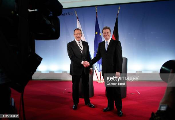 Russian Foreign Minister Sergei Lavrov poses with German Foreign Minister Guido Westerwelle at an informal meeting of NATO member foreign ministers...