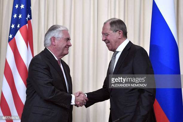 Russian Foreign Minister Sergei Lavrov shakes hands with US Secretary of State Rex Tillerson after a press conference in Moscow on April 12 2017...