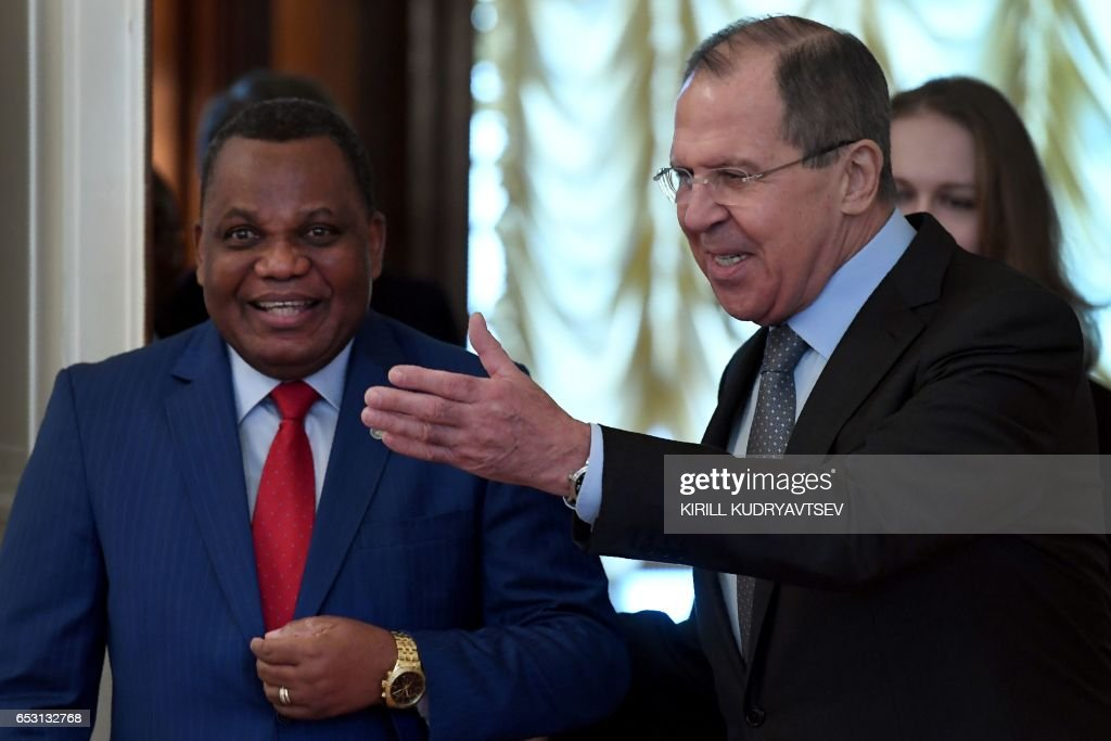 Russian Foreign Minister Sergei Lavrov (R) shows the way to his Congolese counterpart Jean-Claude Gakosso during a meeting in Moscow on March 14, 2017. / AFP PHOTO / Kirill KUDRYAVTSEV
