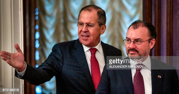 Russian Foreign Minister Sergei Lavrov shows the way to his Mexico's counterpart Luis Videgaray Caso during a meeting in Moscow on November 17 2017 /...
