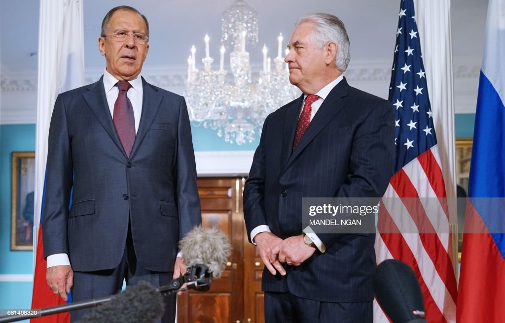 Russian Foreign Minister Sergei Lavrov (L) speaks while posing for photos with US Secretary of State Rex Tillerson in the Treaty Room of the State Department in Washington, DC on May 10, 2017. /