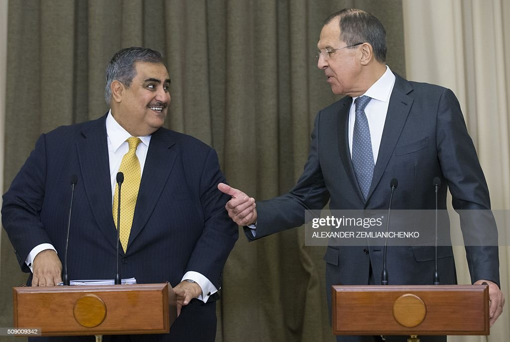 Russian Foreign Minister Sergei Lavrov (R) speaks with his Bahrain's counterpart Sheikh Khaled bin Ahmed al-Khalifa during their press conference following Russian President Vladimir Putin and Bahrain's King Hamad bin Isa Al-Khalifa talks at the Bocharov Ruchei state residence in Sochi, on February 8, 2016. AFP PHOTO / POOL / ALEXANDER ZEMLIANICHENKO / AFP / POOL / ALEXANDER ZEMLIANICHENKO